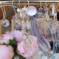 A selection of gold fill earrings with amethyst, drusy quartz and pearl
