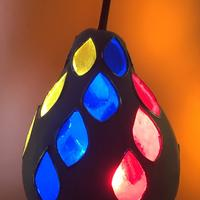 Autumn leaves in stained glass on white gourd