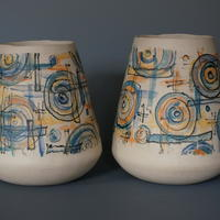 Pair of stoneware slip printed vases