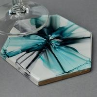 Alcohol ink coaster sealed in resin