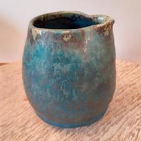 Small jug with  turquoise glaze breaking at the rim