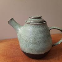 Vulcan black teapot with soft green speckled glaze