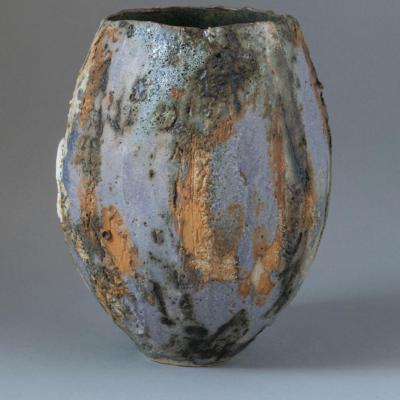 A hand built ceramic vessel inspired by the Rocky Mountains in Canada .