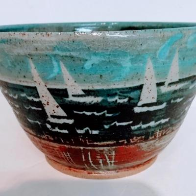 Sailing thrown bowl with oxides and engobes using stencils and sgraffito.  HIgh Fired Stoneware.
