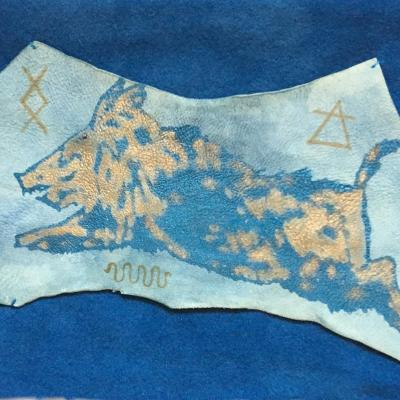 Penda Banner: screen printed and painted wall hanging on woad dyed wool and leather