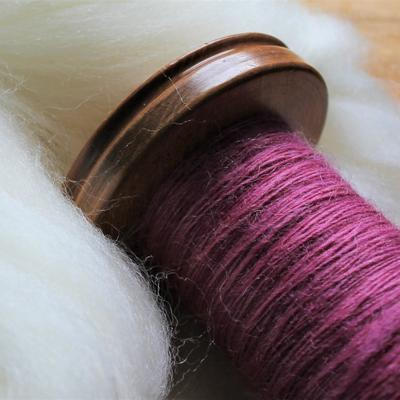 Undyed and hand dyed wool (handspun on bobbin).