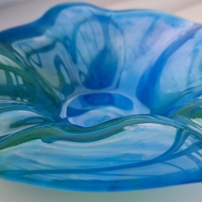 Azure blue, jade green and neo lavender glass flows through in a unique pattern to create this beautiful fused glass bowl.  It is formed into a delicate flower shape in the kiln.  The light shining through these colours will always catch your eye.