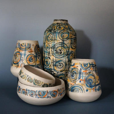 Selection of slip printed pots and bowls