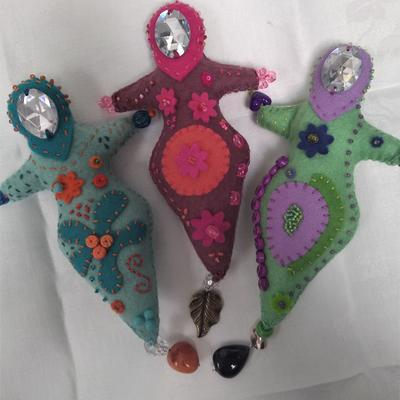 Hand stitched spirit dolls made in felt with hand embroidery, beads and gems.