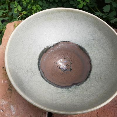 Stoneware bowl with bronze matt basin over matt delicately crackled light green glaze