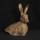Hare alert and poised for danger. Ceramic sculpture stoneware clay with oxides
