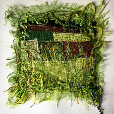 Colourful, highly textured textile landscape picture.