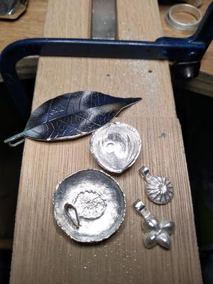 Silver castings on bench peg: works in progress.