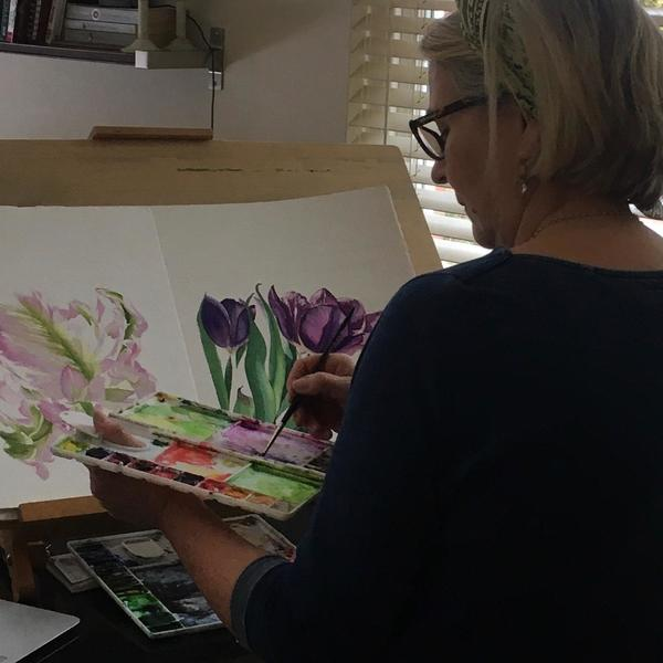 Artist at work, watercolour painting.
