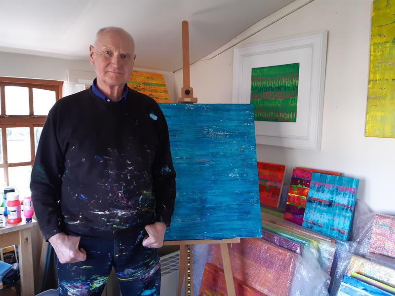Russell in his studio with recent work