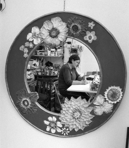 Picture of Sarah at work, reflected in one of her mirrors