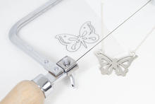 Saw-pierced silver butterfly pendant on silver chain
